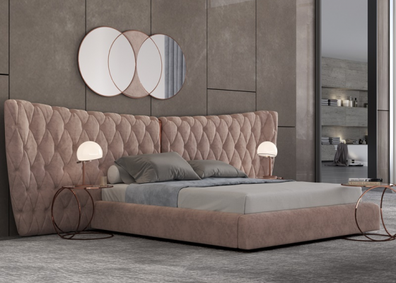 Dormitorio tapizado en capitonné con detalles en acero inoxidable. Mod: KAIPA XXL