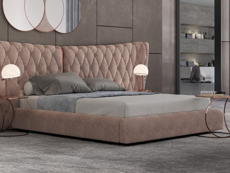 Dormitorio tapizado en capitonn� con detalles en acero inoxidable. Mod: KAIPA XXL
