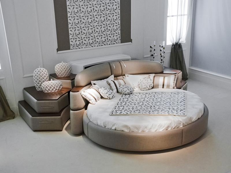 Composición completa cama circular giratoria y mueble librería con