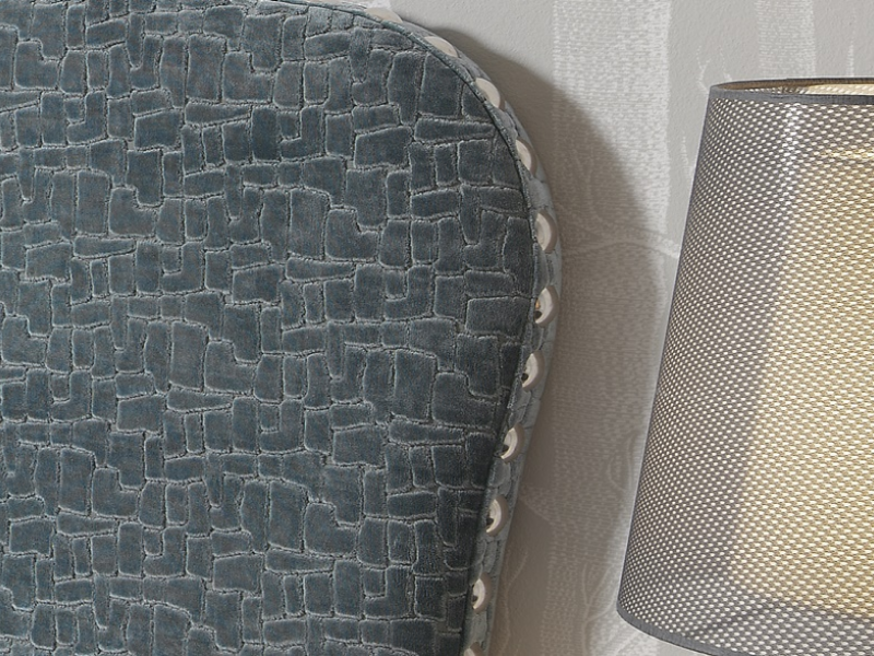 Cabecero tapizado con tachas. Mod. TCOLEY