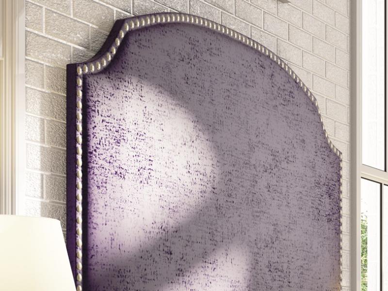 Cabecero tapizado con forma y tachuelas. Mod: NUBIA