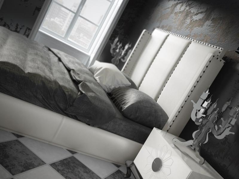 Cama completa tapizada con detalles de tachas en cabecero.Mod: ZENDA