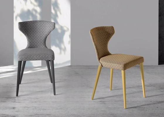 Juego de  2 sillas tapizadas con patas de madera. Mod. ANNA