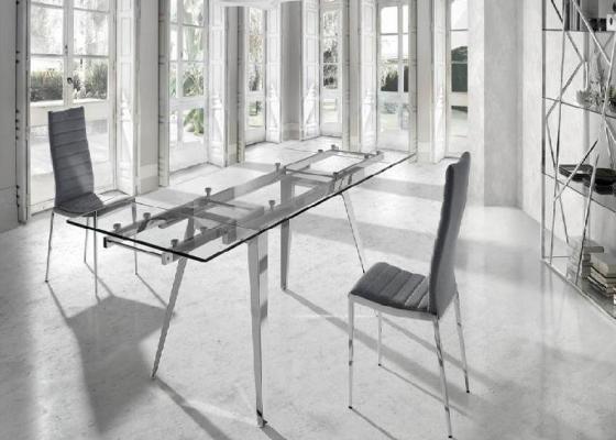 Mesa de comedor extensible con tapa cristal templado y patas de acero . Mod. LOTUS