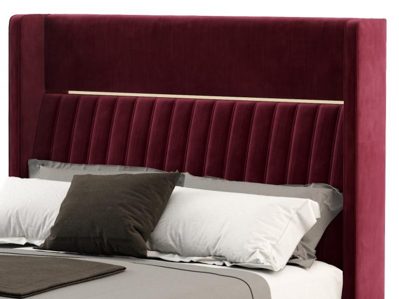 Cabecero tapizado con detalles en acero. Mod: CAMILE