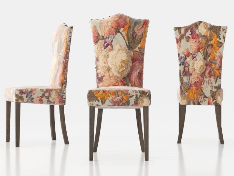 Juego de 2 sillas tapizadas con tachas y patas rectas. Mod: ZORBA