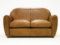 Sofá tapizado en piel genuina.Mod: ROYAL