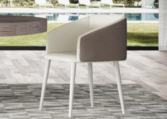 Juego de  2 sillas tapizadas con patas lacadas. Mod. CROSED