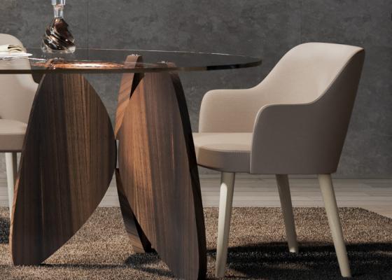 Silla tapizada con patas en madera de nogal. Mod. OSLO