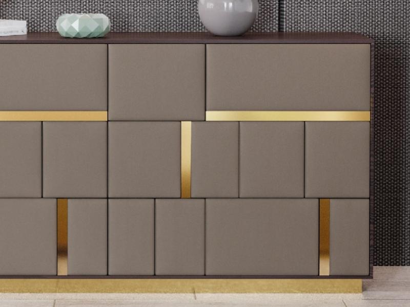 C�moda de 6 cajones en madera de nogal con frentes de cajones  tapizados.Mod: SALMA