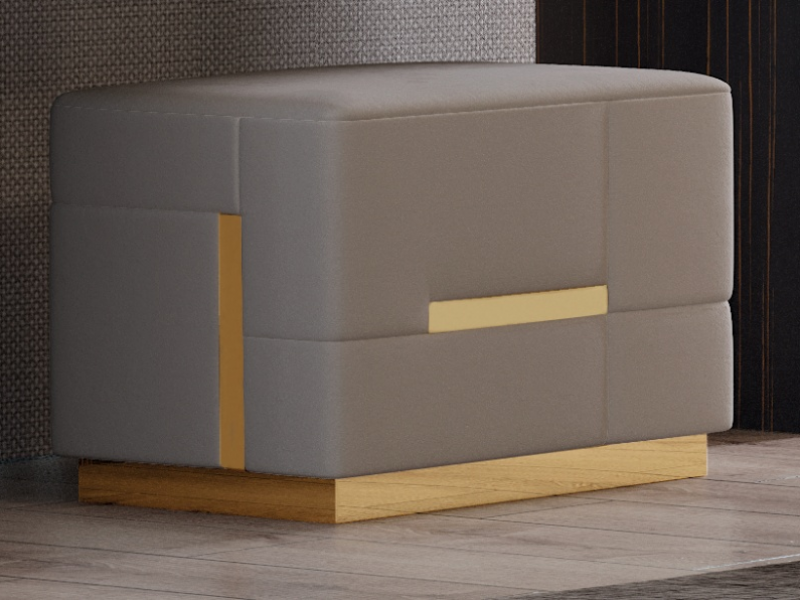 Pouff tapizado con detalles y base en acero inoxidable. Mod: SALMA